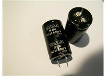 .150uF 385V Tesla TE050 radial produkt v akční ceně  25x40mm vývody snap